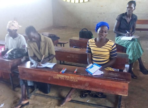 Members of Nyeko Rac Hairdressing group at a literacy training session