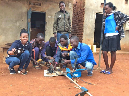 Tam Anyim motorbike repair group with GDPU Project officer Emma Okello, after a training session on small machinery.